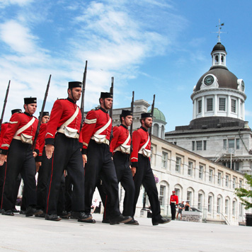 Guard-Marches-with-City-Hall